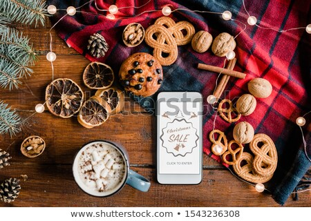 Overview of smartphone surrounded by hot drink, sweet food and walnuts Stock photo © pressmaster