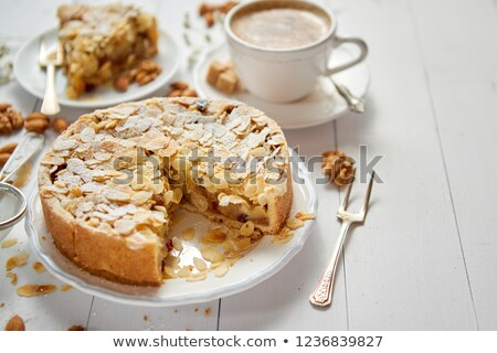 Whole delicious apple cake with almonds served on wooden table Stock photo © dash