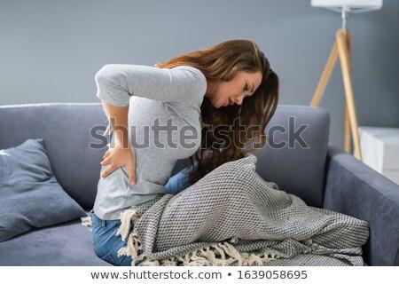 女性 腰痛 座って ソファ 成熟した女性 少女 ストックフォト © AndreyPopov