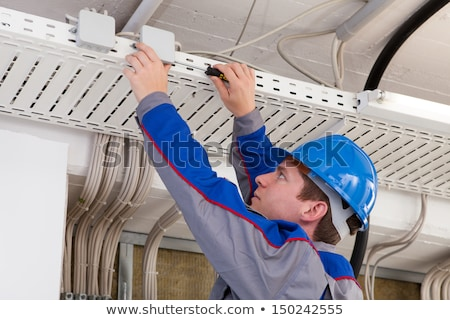 Electrician Install TV Cable In Office Stock photo © AndreyPopov