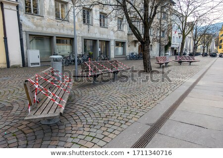 Empty bench in park during a city lockdown in coronavirus pandemic Stock photo © Anneleven