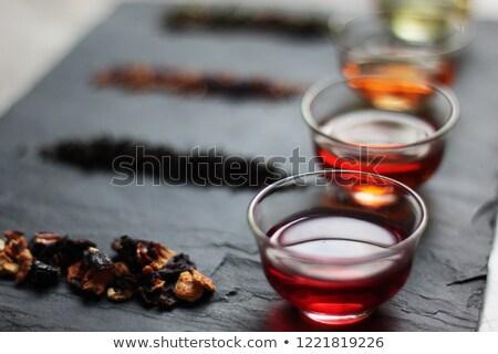Piros tea zöld levél fehér kerámia csésze Stock fotó © Ansonstock