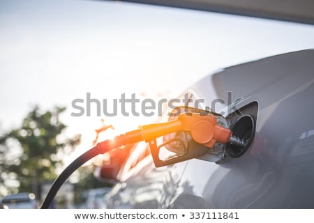 Stock photo: fuel truck which refill hose close up