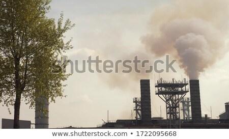 Stockfoto: Rook · fabriek · toegewijd · staal · hemel · wolken