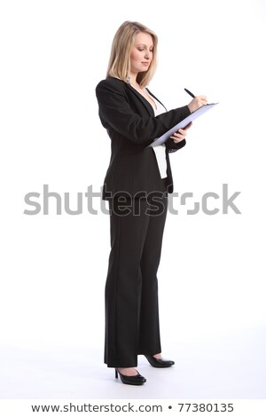 Stock photo: serious black business woman writing on clipboard