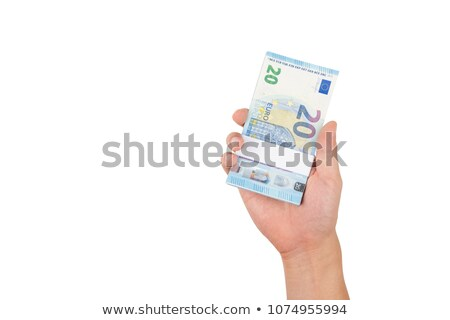 stack of euro banknotes handed to you stock photo © lightkeeper