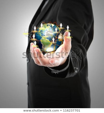 Homem de negócios mundo mãos negócio escritório Foto stock © scornejor