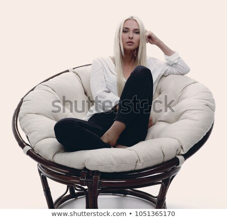 closeup portrait of pretty caucasian woman sitting on comfortabl stock photo © hasloo
