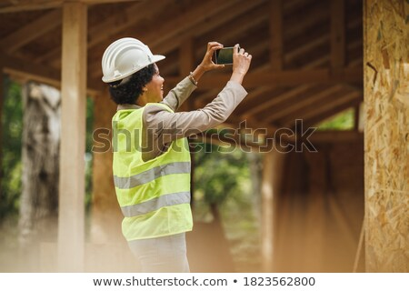 photo of happy woman construction engineer wearing protective or stock photo © hasloo