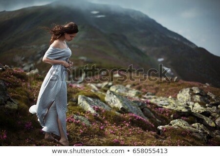Perfect brunette beauty on a mountain Stock photo © konradbak