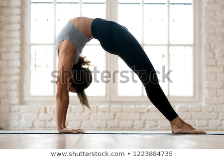 beautiful fitness girl exercising gymnastic bridge Stock photo © Nobilior