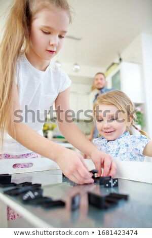 Young girl playing with dominoes Stock photo © photography33