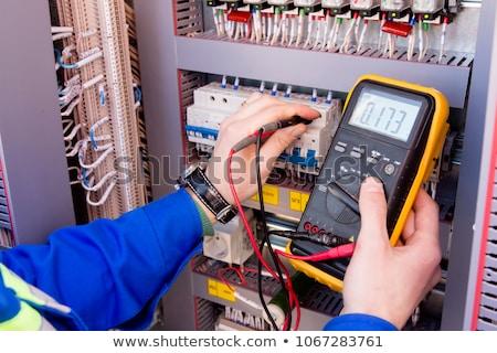 Elektryk napięcie człowiek ściany kabel Zdjęcia stock © photography33