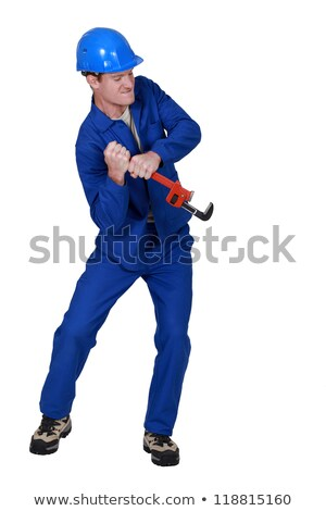Tradesman trying to force open an object using a pipe wrench Stock photo © photography33