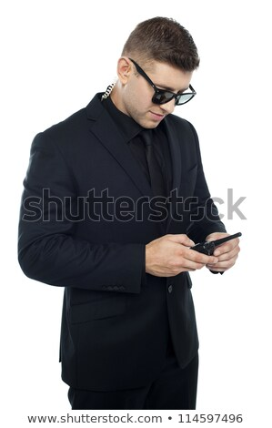 Security officer dialing number on his walkie-talkie Stock photo © stockyimages