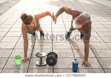 Sporty senior couple with cross trainer Stock photo © photography33