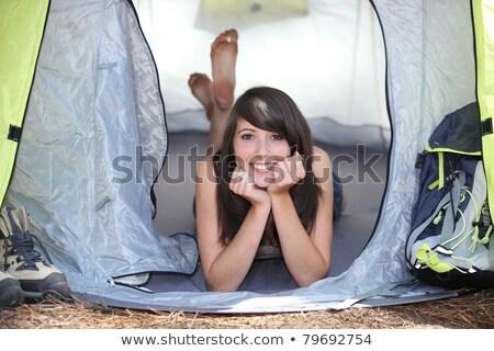 Lány pihen vászon sátor gyönyörű lány vörös ruha Stock fotó © RuslanOmega