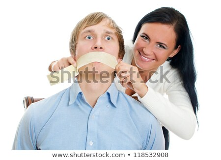 Woman taping boyfriends mouth closed Stock photo © photography33