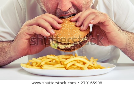 Mann Essen Cheeseburger Essen blau Brot Stock foto © photography33