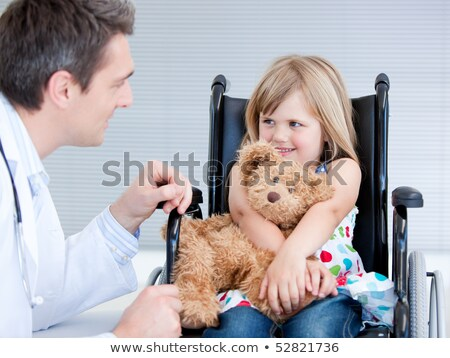 Adorable little girl sitting on a wheelchair stock photo © wavebreak_media