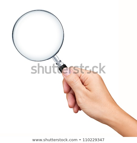 hand with magnifying glass  isolated on white background stock photo © vaeenma