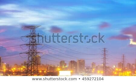 Apartment Buildings & Electricity Pylon Stock photo © eldadcarin