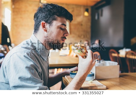businessman eating junk fast food stock photo © lunamarina