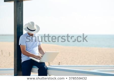 Heyecanlı işadamı oturma bank park dizüstü bilgisayar Stok fotoğraf © jakubzak