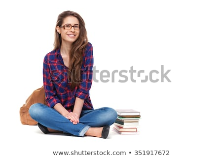 pretty girl-teenager sitting on white background Stock photo © evgenyatamanenko