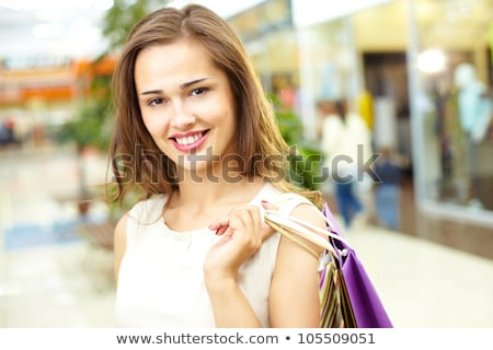 Gorgeous brunette model posing in retail shop Stock photo © get4net