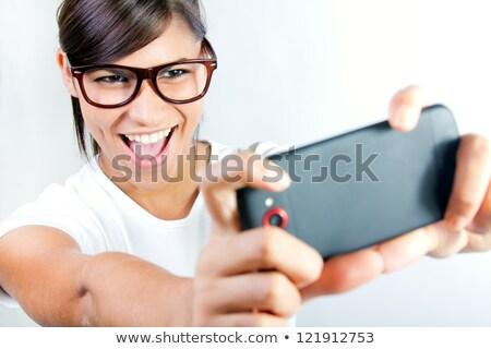 Cute brunette woman taking photo of herself Stock photo © nenetus