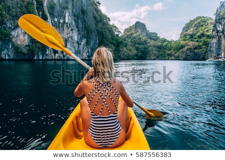 Stock photo: Woman Kayaking on Mountain Lake