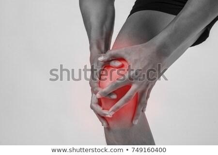 Jonge man lijden knie pijn geïsoleerd witte Stockfoto © AndreyPopov