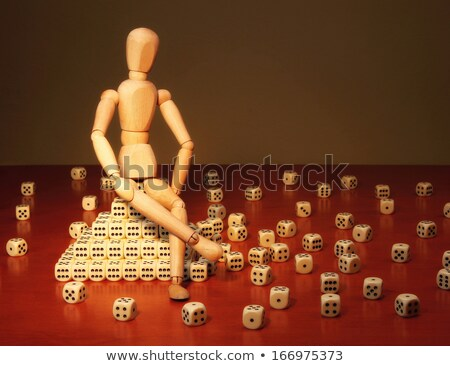Doll and game dices symbolizing a project manager Stock photo © richardjary
