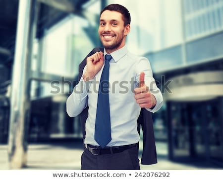 handsome businessman showing thumbs up stock photo © dolgachov