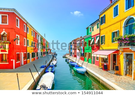 colorful street with canal in burano stock photo © vwalakte