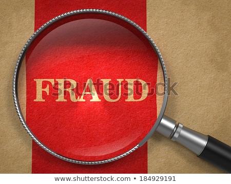 internet fraud magnifying glass on old paper stock photo © tashatuvango