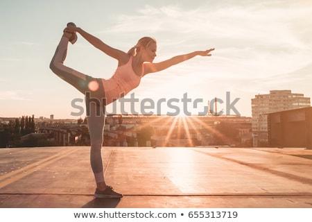 woman doing yoga stretching bridge pose stock photo © hasloo