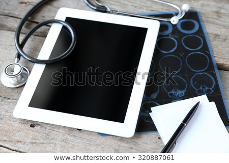 aging on the display of medical tablet stock photo © tashatuvango