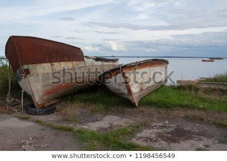 Dois velho remo barcos costa Foto stock © olandsfokus