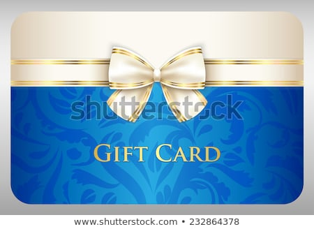 Blue gift card with damask ornament and cream ribbon Stock photo © liliwhite