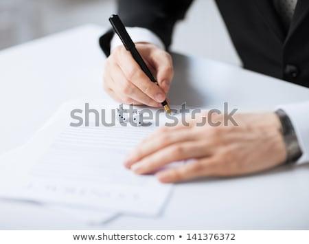 Homem mãos jogos de azar assinatura contrato quadro Foto stock © dolgachov