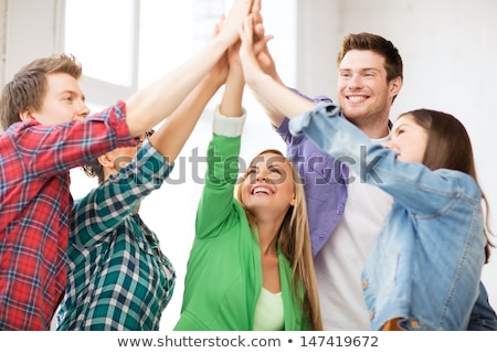 teamwork five friends image concept of group of people happy team victory stock photo © joseph_arce