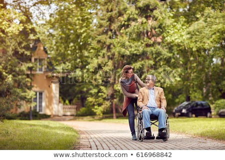 Elderly Man in Wheelchair and Young Woman Stock photo © iofoto