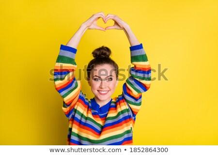 female hands with small rainbow heart Stock photo © dolgachov