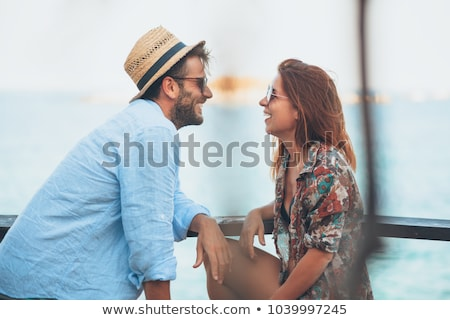 Man flirting with woman outdoors Stock photo © deandrobot