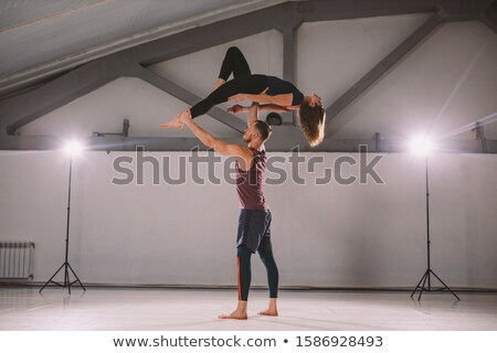 Two artistic gymnast doing paired exercises Stock photo © bezikus