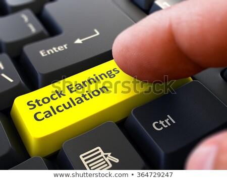 Amarelo botão ganhos cálculo preto Foto stock © tashatuvango