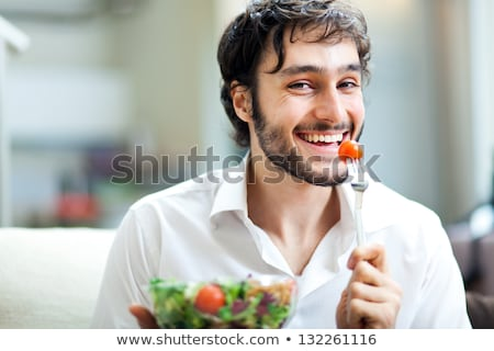 man eating salad stock photo © rastudio
