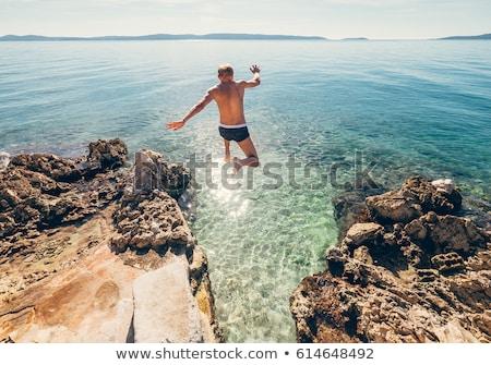 Saltando adolescente menino água sorrir esportes Foto stock © Paha_L
